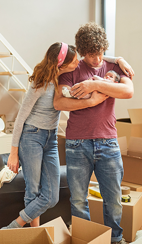 Family with baby in a new home