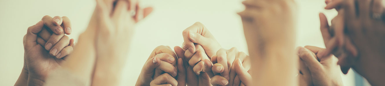 Group holding up hands together